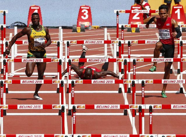 Mikel Thomas of Trinidad and Tobago (C) falls during his men's 110 metres hurdles heat at the IAAF World Championships at the National Stadium in Beijing, China August 26, 2015. (Photo by David Gray/Reuters)