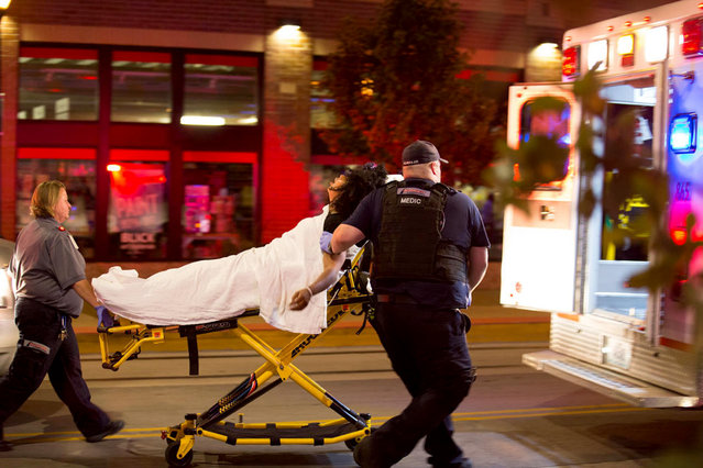 A woman is sent to hospital during a protest in St. Louis, Missouri on September 16, 2017. Police on Saturday put up barricades around the courthouse and police headquarters in St. Louis, Missouri, bracing for more protests that are expected to come in days. (Photo by Dane Iwata/Xinhua via ZUMA Wire)