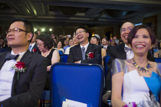 "Audience members react to the crowning of Miss NY Chinese 2014 at the end of the show. ""Going through the pageant made me realize that it's okay to not conform"", said contestant Charis Chu. ""We're all different, we're all imperfect. As long as we are confident and have a good heart, then we are beautiful"". (Photo and caption by John Brecher/Sahra Vang Nguyen/NBC News)"