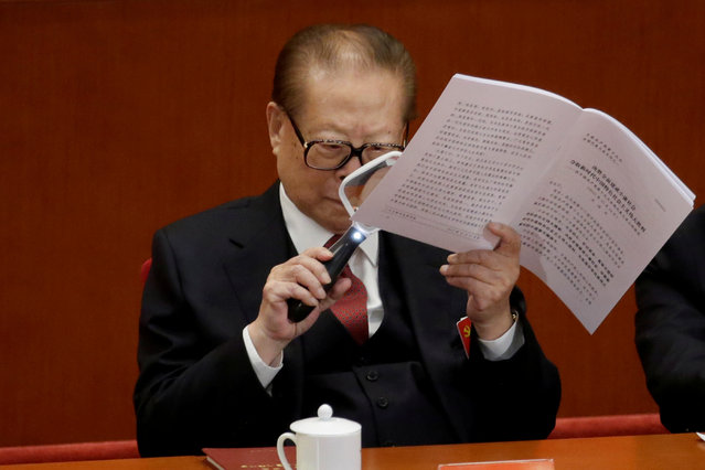 Former Chinese President Jiang Zemin uses a magnifier as he reads Chinese President Xi Jinping's report during the opening of the 19th National Congress of the Communist Party of China at the Great Hall of the People in Beijing, China on October 18, 2017. (Photo by Jason Lee/Reuters)