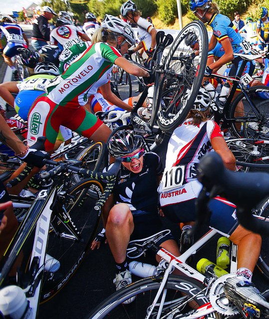 New Zealand's Kate Chilcott screams in pain after a crash of the pack during the women's road race of the World Championship Cycling in Valkenburg, Netherlands, on September 22, 2012. (Photo by Bas Czerwinski/Associated Press)