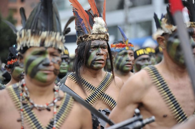 Ecuadorian Shuar Indian soldiers participate in a military parade to commemorate the Battle of Pichincha of May 24, 1822 in Quito May 24, 2012. (Photo by Gary Granja/Reuters)