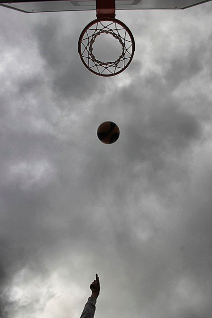 """Basketball"". Basket in the air. Photo location: Milan. (Photo and caption by Cristiano Ragab/National Geographic Photo Contest)"