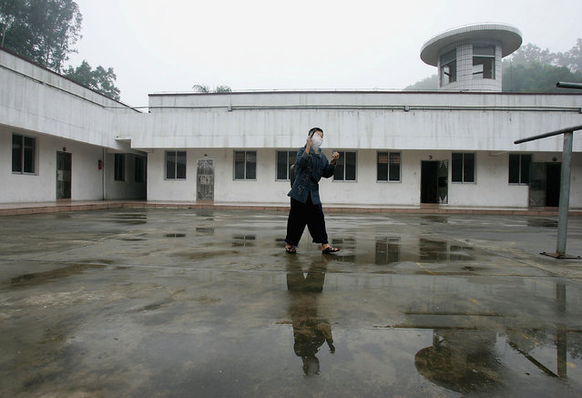 A kid enjoys a cigarette at an assistance center February 23, 2005 in Shenzhen, Guangdong Province, China. (Photo by Cancan Chu/Getty Images)