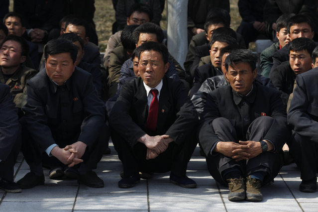 A group of North Korean visitors listen to a guide at Mangyongdae, the birthplace of North Korea founder Kim Il-sung, in Pyongyang, April 9, 2012. (Photo by Bobby Yip/Reuters)