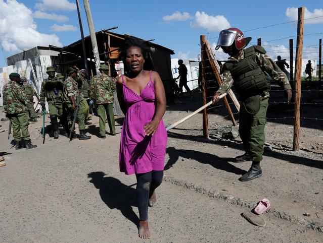 A police officer prods a supporter of Kenyan opposition National Super Alliance (NASA) in Nairobi, Kenya, November 28, 2017. (Photo by Thomas Mukoya/Reuters)