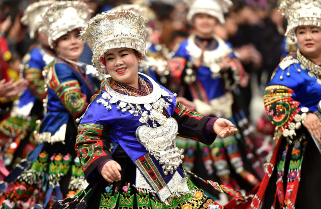 Chinese people of Miao ethnic minority dressed in traditional silver-decorated clothes and headwears take part in a parade to celebrate their traditional New Year Festival in Leishan county, Qiandongnan Miao and Dong Autonomous Prefecture, southwest China's Guizhou province on November 23, 2017. It falls during the tenth month of the lunar calendar (late October or November). This is the most important festival for the Miao ethnic group. It symbolizes the start of something new and fruitful. (Photo by Imaginechina/Rex Features/Shutterstock)
