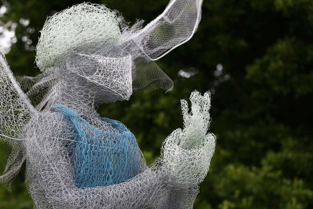 """Luke Perry's man made sculpture of a winged medical worker is seen in Lightwoods Park on May 21, 2020 in Bearwood, England. The British government has started easing the lockdown it imposed two months ago to curb the spread of Covid-19, abandoning its """"stay at home"""" slogan in favour of a message to """"be alert"""", but UK countries have varied in their approaches to relaxing quarantine measures. (Photo by Cameron Smith/Getty Images)"""