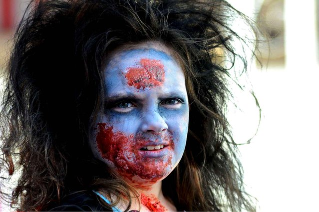 Miranda Lawson, of Shenandoah, Pa., is made up as a zombie at the annual Shenandoah Halloween Parade in Shenandoah, Pa., Sunday, October 26, 2014. The event was sponsored by the Shenandoah Area Youth Volunteers. (Photo by Jacqueline Dormer/AP Photo/The Republican-Herald)