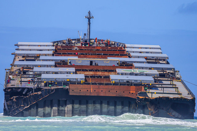 A view of the front section of the vessel MV Wakashio, belonging to a Japanese company but Panamanian-flagged that ran aground near Blue Bay Marine Park, is seen after breaking into two parts off the coast of south-east Mauritius on August 17, 2020. Japan is sending a second team of experts to help clean up more than 1,000 tonnes of oil that leaked from a Japanese-owned bulk carrier into pristine waters off the coast of Mauritius. The MV Wakashio ran aground on a coral reef on July 25 and began oozing oil more than a week later. (Photo by Daren Mauree/L'Express Maurice/AFP Photo)