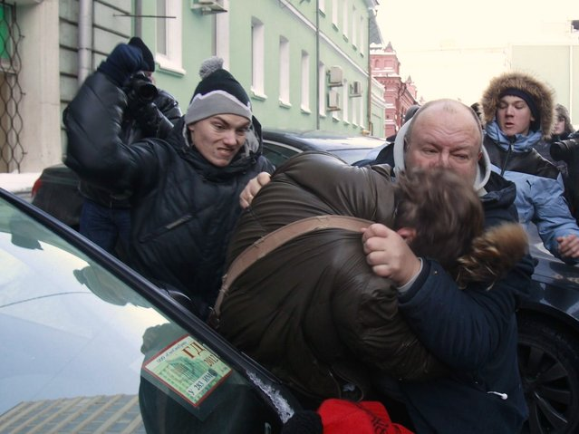 Orthodox activists clashes with a gay rights campaigner during a protest outside of the State Duma, Russian Parliament's lower chamber, in downtown Moscow, January 22, 2013. (Photo by Ilya Pitalev/RIA Novosti)