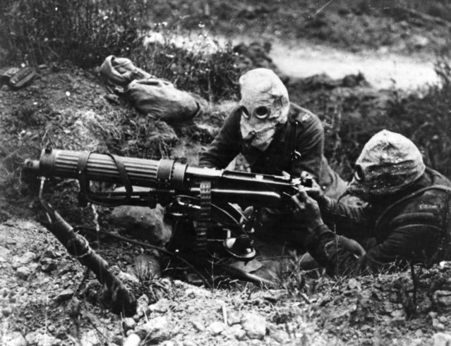 Gas-masked men of the British Machine Gun Corps with a Vickers machine gun during the first battle of the Somme, 1916. (Photo by General Photographic Agency/Getty Images)