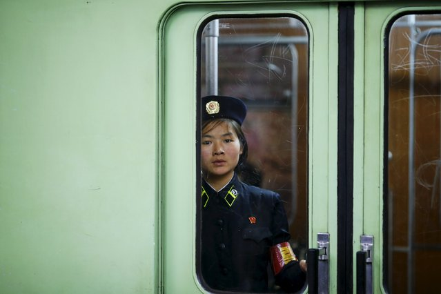 A railway worker looks from inside a train leaving a subway station visited by foreign reporters during a government organised tour in Pyongyang, North Korea October 9, 2015. (Photo by Damir Sagolj/Reuters)