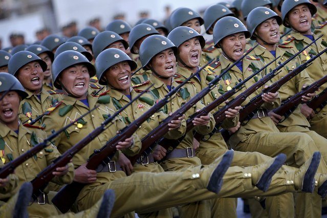 Soldiers shout slogans as they march past a stand with North Korean leader Kim Jong Un during the parade celebrating the 70th anniversary of the founding of the ruling Workers' Party of Korea, in Pyongyang October 10, 2015. (Photo by Damir Sagolj/Reuters)