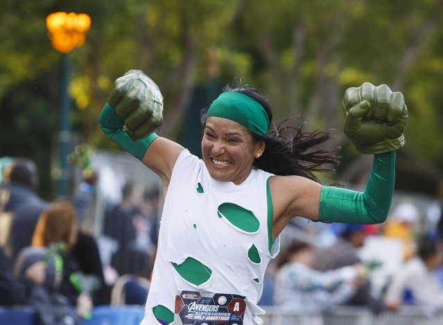 Maxine Cunningham pumps her Thing character's fists after completing the Avengers Super Heroes Half Marathon in and around the Disney Parks in Anaheim, California November 16, 2014. (Photo by Eugene Garcia/Reuters)