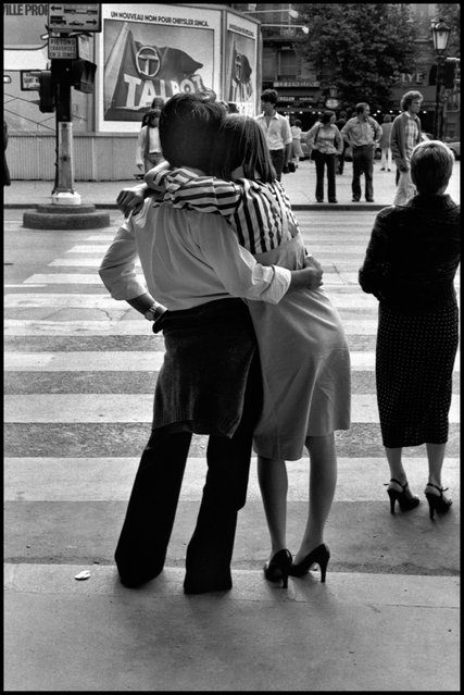 The body language of love. A couple waiting to cross the Boulevard St. Michel in the Latin Quarter, Paris. I wish so much I could find this couple today, where ever they are, and whatever the circumstances of their lives-this is a moment they'd want to remember. 1978. (Photo and comment by Peter Turnley)