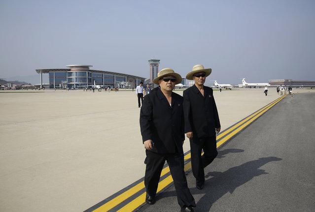 North Korean men walk on the tarmac of the newly renovated Kalma Airport on Saturday, September 24, 2016, in Wonsan, North Korea. (Photo by Wong Maye-E/AP Photo)