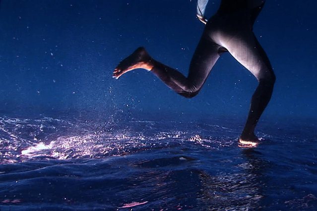 A freediver uses weights, yoga and camera tricks to create the illusion of walking underwater for a film which took three years to shoot and was completed in 2013 in El Hierro, Canary Islands. Like a scene from a Hollywood science-fiction movie, this trick footage shows a man apparently walking on water. The underwater film was shot by biologist Armiche Ramos and brothers Armando and Francisco del Rosario, who used their expertise in freediving to create the illusion. (Photo by Ocean Brothers/Barcroft Media/ABACAPress)