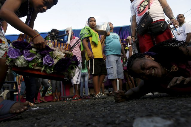 A worshipper reacts as she crawls on the ground during the annual celebratory pilgrimage in Portobelo, in the province of Colon October 21, 2015. (Photo by Carlos Jasso/Reuters)