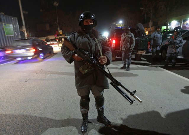Police officers arrive at the site of an incident in Kabul November 27, 2014. An explosion shook houses in the diplomatic quarter of the Afghan capital on Thursday evening and was followed by heavy gunfire that could still be heard an hour later, according to Reuters witnesses and security officials. (Photo by Omar Sobhani/Reuters)