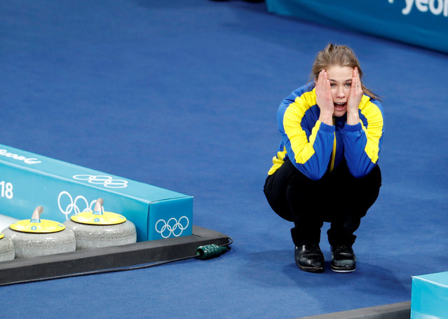 Anna Hasselborg, of Sweden, celebrates after winning the gold medal in their women' s curling final in the Gangneung Curling Centre at the 2018 Winter Olympics in Gangneung, South Korea, Sunday, February 25, 2018. (Photo by Cathal Mcnaughton/Reuters)