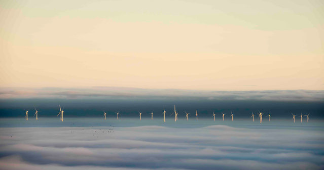 "When the Fog Parted, north Wales coast. Changing Landscapes special award winner. ""The blanket of fog over the Irish Sea parted revealing the line of wind turbines off the north Wales coast. Tiny black dots appeared as a flock of migrating birds flew past over the fog. Do they know the way, or has the gap in the fog helped them?"". (Photo by Graham Eaton/UK Landscape Photographer of the Year 2020)"