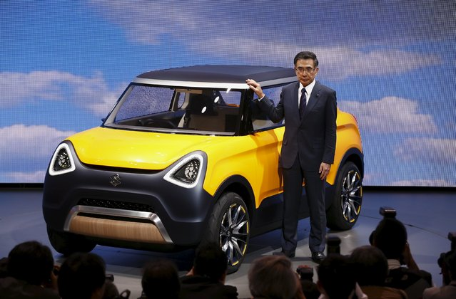 Suzuki Motor's President Toshihiro Suzuki poses with the Suzuki Mighty Deck concept car at the 44th Tokyo Motor Show in Tokyo, Japan, October 28, 2015. (Photo by Thomas Peter/Reuters)