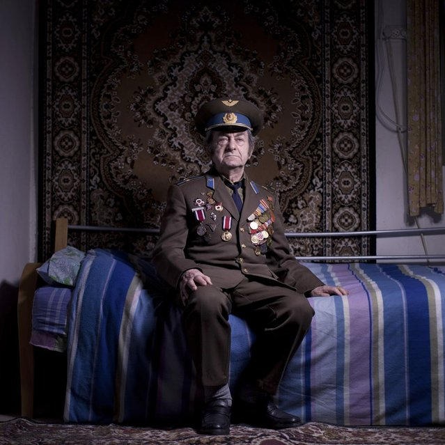 In this photo made on Friday, April 12, 2013, Soviet Jewish World War veteran Aharon Kavishaner poses for a portrait at his house in the southern Israeli city of Ashkelon. Kavishaner joined the Red Army in 1942, as an air force mechanic and served in the 4th Ukrainian Front, a Soviet army group. Kavishaner immigrated to Israel in 1991. About 500,000 Soviet Jews served in the Red Army during World War Two, and the majority of those still alive today live in Israel. (Photo by Oded Balilty/AP Photo)