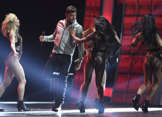 """Ricky Martin performs """"Que se Sienta El Deseo"""" at the 16th annual Latin Grammy Awards at the MGM Grand Garden Arena on Thursday, November 19, 2015, in Las Vegas. (Photo by Chris Pizzello/Invision/AP Photo)"""