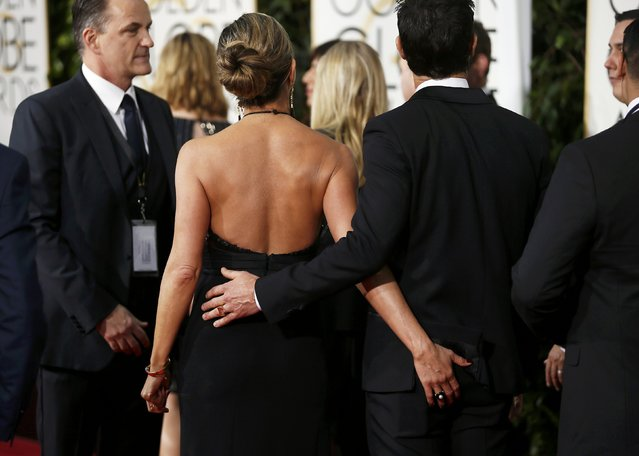 Actors Justin Theroux and Jennifer Aniston arrive at the 72nd Golden Globe Awards in Beverly Hills, California January 11, 2015. (Photo by Danny Moloshok/Reuters)