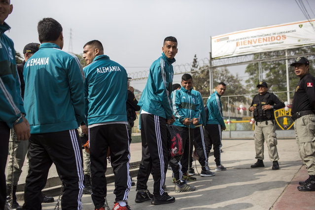 Escorted by prison guards, inmates of a football team wait in a line before entering San Juan de Lurigancho prison, Lima, Peru, Thursday, May 24, 2018. Inmates of 17 prisons, including four for women, participated in the First Interprison World Cup Lima 2018, organized by the National Penitentiary Institute. (Photoby Rodrigo Abd/AP Photo)