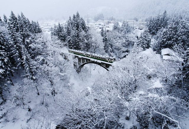 """White village"". Tadami line has been running the Aizu region of Fukushima Prefecture. Winter of Aizu region is famous as one of the leading heavy snowfall area in Japan. (Photo and caption by Hideyuki Katagiri/National Geographic Traveler Photo Contest)"