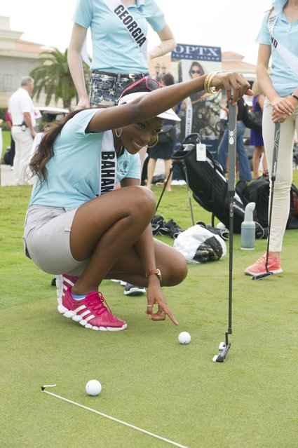 Tomii Culmer, Miss Bahamas 2014, practices for a putting contest at the 63rd annual Miss Universe Pageant in Miami, Florida in this January 12, 2015 handout photo provided by Miss Universe Organization. (Photo by Reuters/Miss Universe Organization)