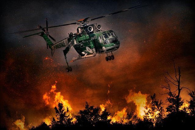 The proximity to the flames is unbelievable in this remarkable shot taken by daredevil photographer Antonio Grambone. (Photo by Antonio Grambone/Caters News Agency Ltd)