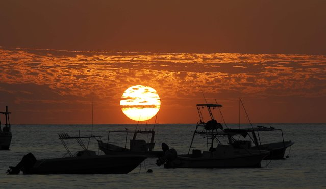 Boats are pictured during sunset at Herradura Beach in Punarenas, January 8, 2015. (Photo by Juan Carlos Ulate/Reuters)