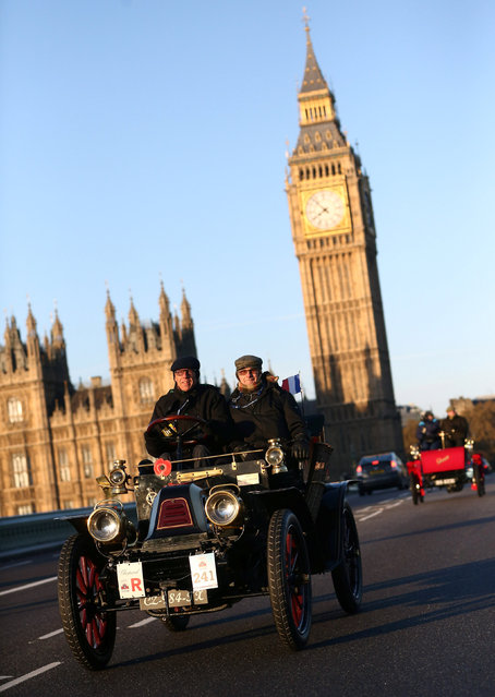 Participants drive their vintage car over Westminster bridge during the annual London to Brighton veteran car run in London, Britain November 6, 2016. (Photo by Neil Hall/Reuters)