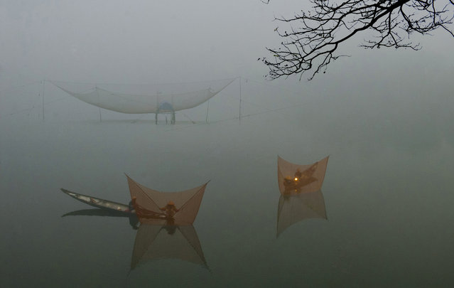 """Fish net"". Some fishermen set up net on a river early morning. It's about 6:am, this time is end of winter. Location: Hue city, VN. (Photo and caption by Huong Mai/National Geographic Traveler Photo Contest)"