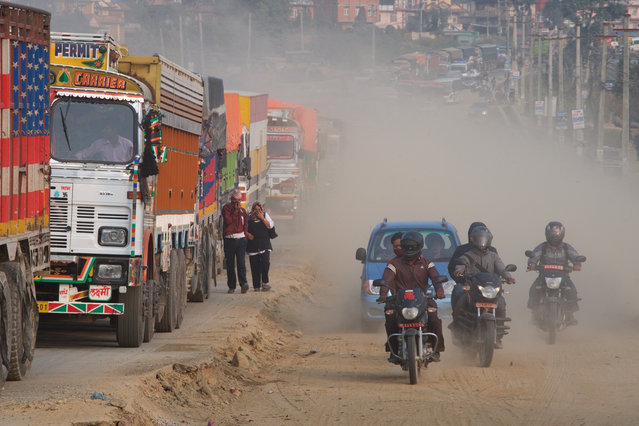 """The expansion of Kathmandu's ring road has left commuters choking on dust and caught in hour-long traffic jams. Groups opposed to the road expansion also claim it is threatening the city's cultural heritage. """"(Road expansion) is displacing the indigenous Newar people from their own land. Lots of heritage sites will be affected … Kathmandu needs to be preserved"""", says Suraj Maharjan of the Save Nepa Valley campaign. (Photo by Pete Pattisson/The Guardian)"""