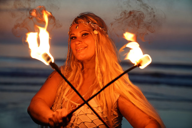 Fire and Light Choreographer Penella Bee from Bee-Enchanted practices her routine on Seaburn beach in Sunderland, England early morning on September 15, 2020. (Photo by Owen Humphreys/PA Images via Getty Images)