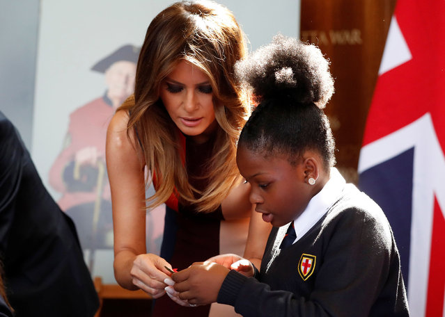 U.S. First Lady Melania Trump helps veterans and schoolchildren assemble Remembrance Day poppies at the Royal Hospital Chelsea in London, Britain, July 13, 2018. (Photo by Yves Herman/Reuters)