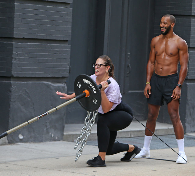 Plus Size model Ashley Graham and shirtless boyfriend Justin Ervin spotted working out outside the Dogpound gym in New York City on July 23, 2018. (Photo by Turgeon-Steffman/Splash News and Pictures)