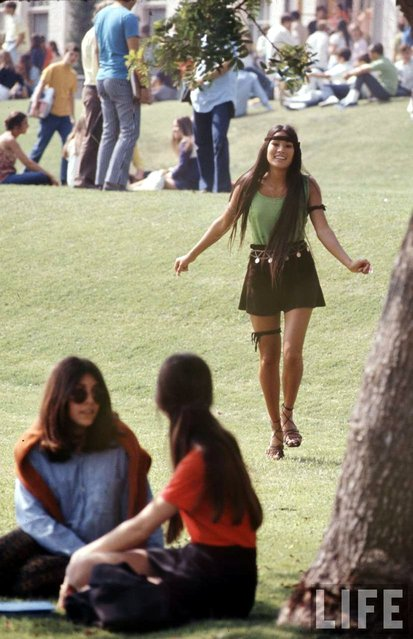 "A Southern California high school student walks toward classmates while wearing the ""Mini Jupe"" skirt, 1969. (Photo by Arthur Schatz/Time & Life Pictures/Getty Images)"