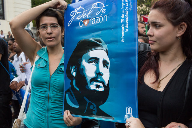 Students hold posters of Fidel at the University of Havana during a demonstration in his honor on Saturday morning in Havana, Cuba on November 26, 2016. (Photo by Lisette Poole/The Washington Post)