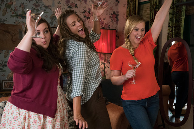 "This image released by STX Films shows Aidy Bryant, from left, Busy Philipps, and Amy Schumer in a scene from ""I Feel Pretty"". (Photo by Mark Schafer/STX via AP Photo)"