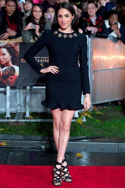 "US actress Meghan Markle poses for pictures on the red carpet upon arrival for the world premier of the film ""The Hunger Games: Catching Fire"" in Leicester Square, central London, on November 11, 2013. The dystopian universe of ""The Hunger Games"" returns to cinema screens aiming to harness the star power of Oscar-winning actress Jennifer Lawrence and convey an unambiguous message of youthful rebellion. (Photo by Andrew Cowie/AFP Photo)"
