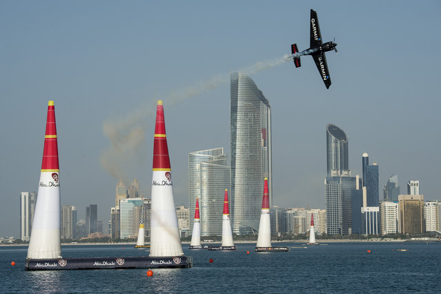 In this photo provided by Joerg Mitter via Global-Newsroom, Pete McLeod of Canada performs during the finals of the first stage of the Red Bull Air Race World Championship in Abu Dhabi, United Arab Emirates, Saturday, February 14, 2015. (Photo by Joerg Mitter/AP Photo/Global-Newsroom)