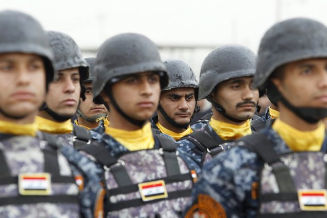 Troops of the Interior Ministry take part in a ceremony marking the Iraqi Police Day at a police academy in Baghdad January 9, 2016. (Photo by Khalid al Mousily/Reuters)