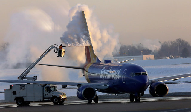 A Southwest Airlines plane is de-iced at the Indianapolis International Airport, early Tuesday, February 24, 2015, in Indianapolis. The early morning temperature at the airport was below zero. (Photo by David J. Phillip/AP Photo)