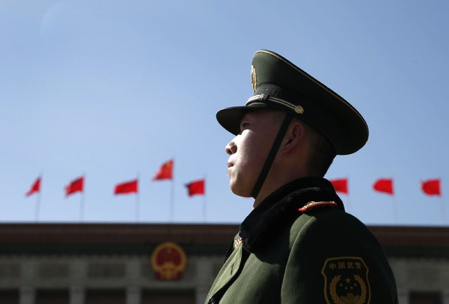 A paramilitary policeman stands guard in front of the Great Hall of the People ahead of the opening session of Chinese People's Political Consultative Conference (CPPCC) at Tiananmen Square in Beijing, March 3, 2015.  REUTERS/Kim Kyung-Hoon