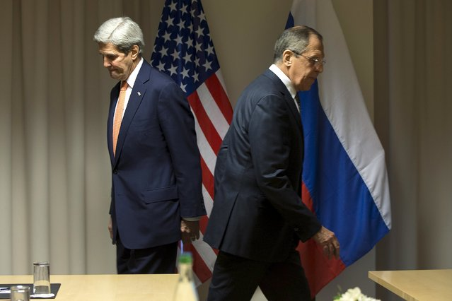 U.S. Secretary of State John Kerry and Russian Foreign Minister Sergey Lavrov walk to their seats for a meeting about Syria, in Zurich, Switzerland,  January 20, 2016. (Photo by Jacquelyn Martin/Reuters/Pool)